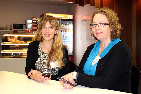 Nutrition researchers Amy Ashman, left, and Dr Megan Rollo with their smartphones.
