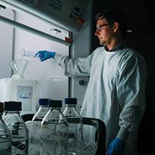 Dr Gerard Kaiko mixing hand sanitiser